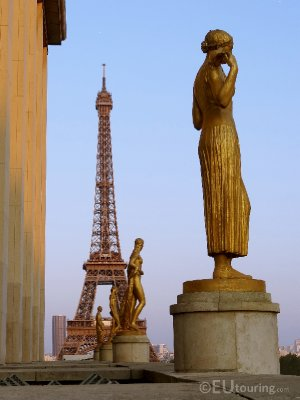 Golden statues and the Eiffel Tower seen from the Palais de Chaillot