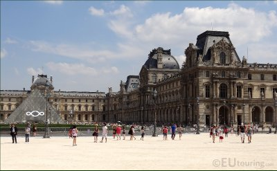 I M Pei in the courtyard of the Louvre