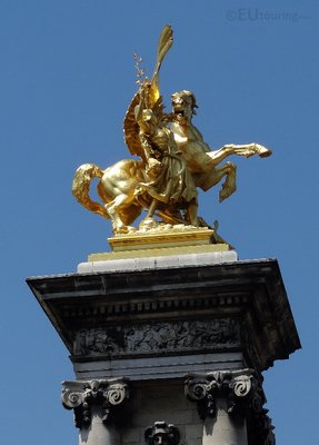 Golden statue on top of the column