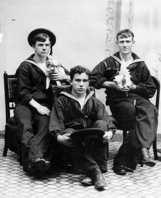 Aura Clark (middle) has his photo taken with his mates in Yokohama, Japan during his voyage with the Great White Fleet