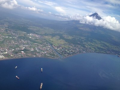 Aerial view of the Mayon Volcano and Legazpi City