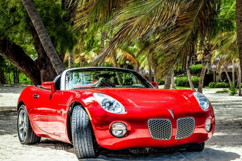 Red pontiac at the Cap Cana beach