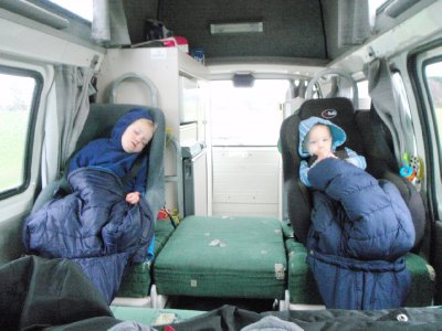 Kids rugged up asleep driving