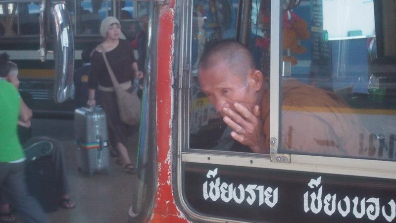 Monk cleans his nose