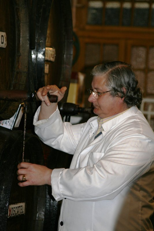 Pouring Malaga wine