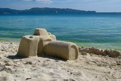 Camera's sand on white beach