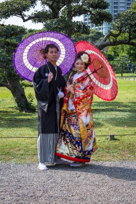 A couple having their engagement photos taken at Hamarikyu Gardens