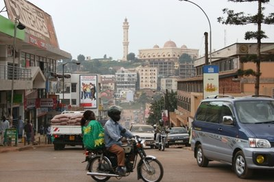 Kampala - boda boda on dusty road