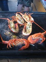 Crayfish cooking on grill