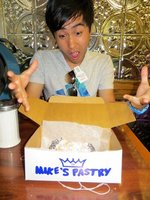 Vinnie with Mike's Pastry cannoli