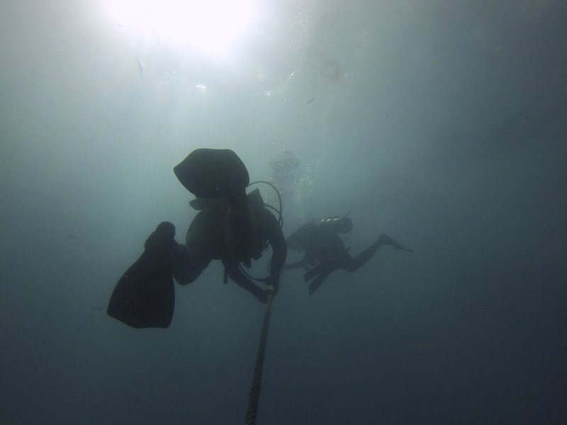 Divers ascend from the wreck of the Spiegel Grove