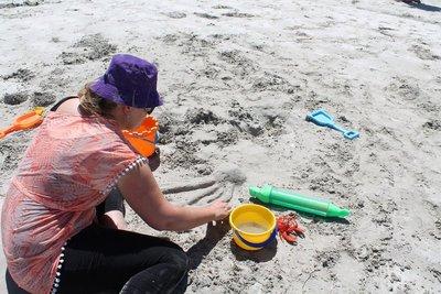Flick making sandcastles