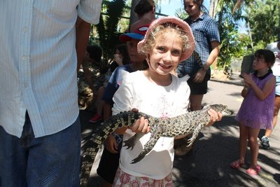 Holding the baby croc