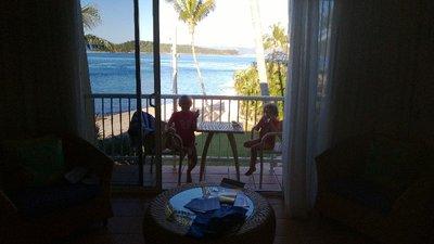 Jasmine and Lyssy sitting on the balcony having a toast!