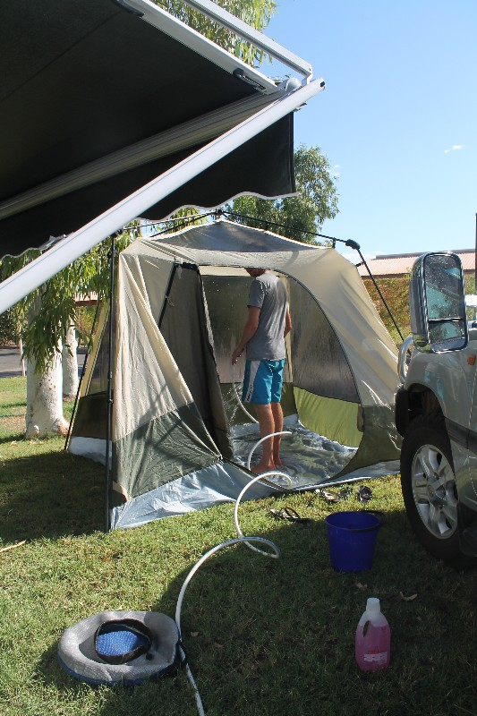 Hosing out the smelly tent