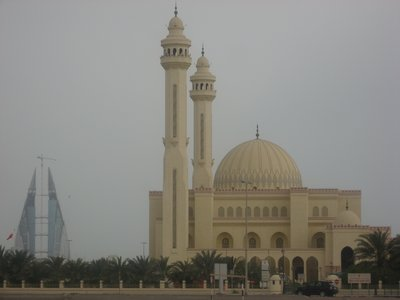 Grand Mosque with modern skyscraper background