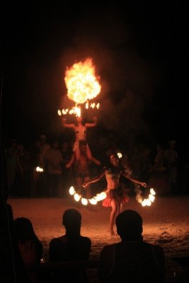 Watch the amazing fire dance performance by locals