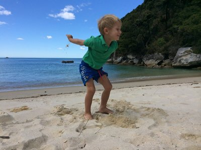 Ollie enjoying Marahau beach in the Abel Tasman beaches