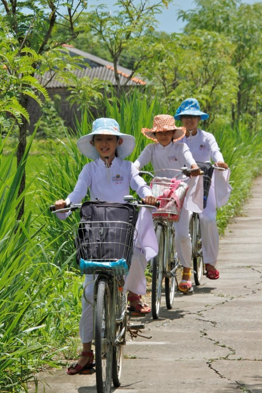 Riding home from school in the Mekong Delta