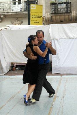An outdoor tango show at a market