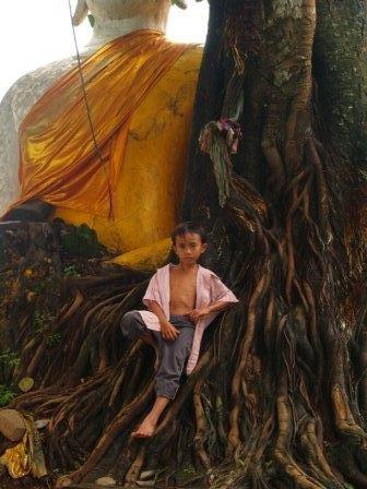 boy posing with Buddha