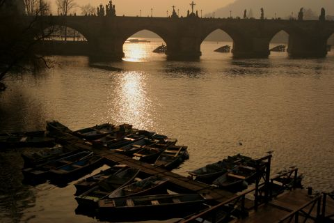 Boats lay idle at Charles Bridge - Prague