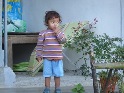 Nepalese boy with crocs