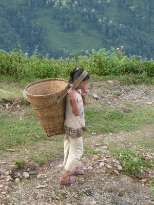 Girl carrying load with head