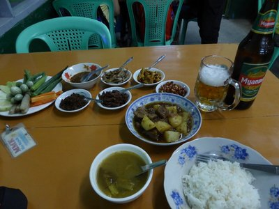 A typical meal: beef curry and a beer