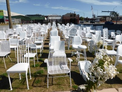 Memory of 2011 earthquake victims, empty white chairs