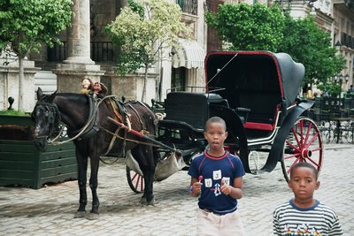 Cuban kids on the Plaza San Francisco in Havana