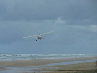 Plane taking off on Fraser Island's beach