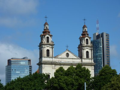 Old meets new: St. Raphael&#39;s Church vs modern glassy skycrapers in Vilnius