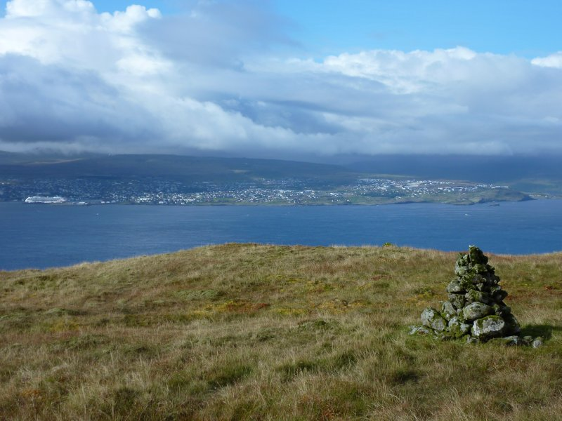 Cairns marking the path; Tórshavn in the back