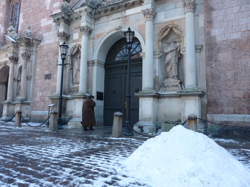 Woman entering the St. Peter's Lutheran church, Riga