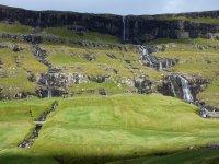 Green blanket with waterfalls near Saksun, Streymoy island