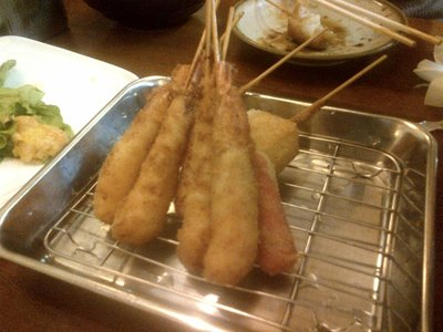 Some kind of meat on a stick.