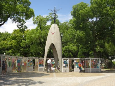 "Children's Peace Monument. The sign near it read, ""This monument stands in memory of all children who died as a result of the atomic bombing to Hiroshima. The monument was originally inspired by the death of Sadako  Sasaki...""."
