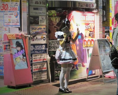 A maid promoting her café.