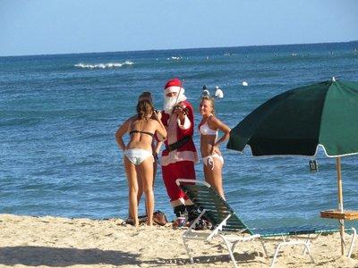 Hawaiian Santa playing the fiddle...