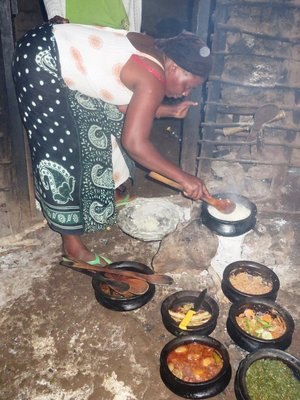 Preparing a village meal for us, Mto Wa Mtu village, Tanzania