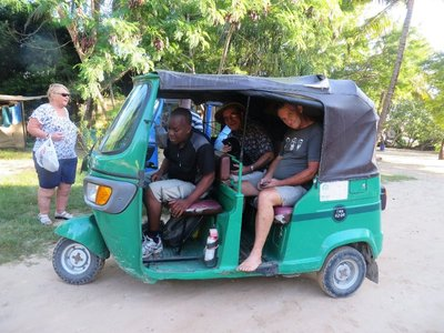 We double up in a tuk tuk to travel to the Dar es Salaam harbour ferry on our journey to Zanzibar