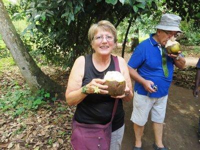 Enjoying a drink of coconut liquid at the Spice Farm, Zanzibar