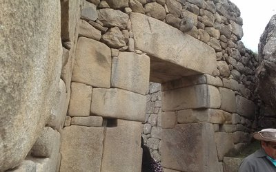massive doorway between men's and women's area. There are pins carved out of the rock to hold a wooden door lashed on hinges and locked through the rock at the top with the hole in it.