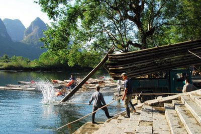 Unloading bamboo rafts, Yulong River