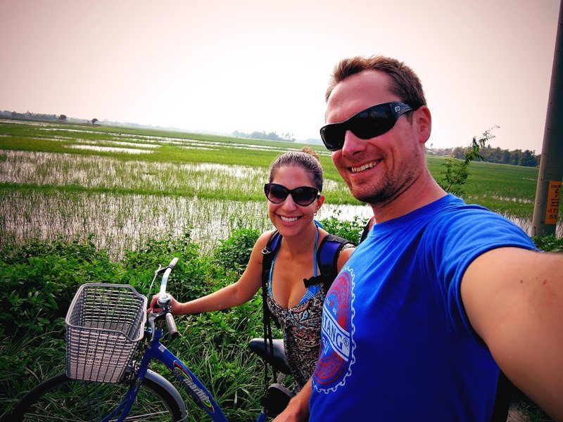 riding our bikes through rice fields