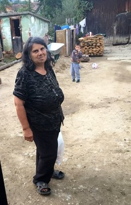 Recipient of Food packet in Orlat, Sibiu County, Romania.