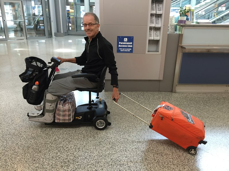Dave with his little trolley. We're SO THANKFUL we found this little scooter in LA!