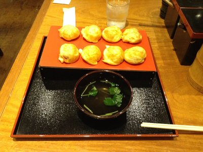 Akashi yaki with a bowl of the dashi stock.