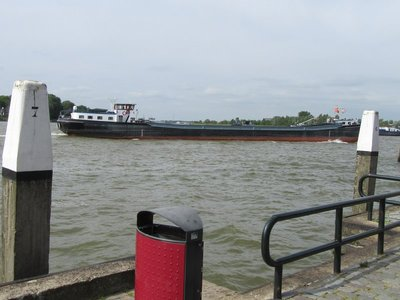 River across the street with freighter going by